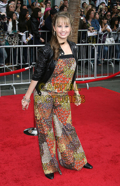 "DEBBY RYAN .""Hannah Montana: The Movie"" Los Angeles Premiere held at the El Capitan Theatre, Hollywood, California, USA, .02 April 2009..full length black leather jacket brown print catsuit pantsuit romper jumpsuit .CAP/ADM/MJ.©Michael Jade/Admedia/Capital Pictures"