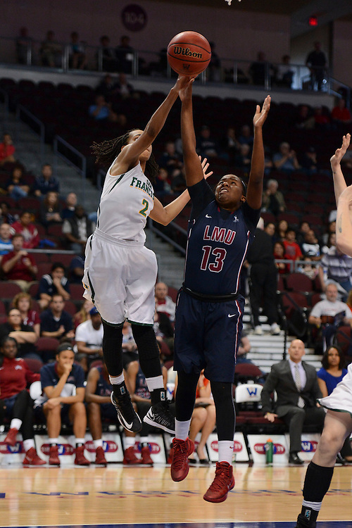 March 6, 2014; Las Vegas, NV, USA; Loyola Marymount Lions guard Deanna Johnson (13) shoots the ball against the San Francisco Lady Dons during the second half of the WCC Basketball Championships at Orleans Arena.