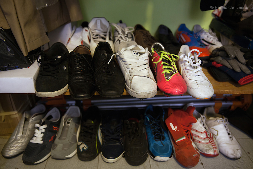 """Rodrigo's prized collection of left shoes at his home in Mexico City, Mexico on September 25, 2014. He says that he gives the right shoes to players who are missing a left leg. Rodrigo Fernandez Loya, 25, a player from Guerreros Aztecas, lost his right leg in 2012 when he saved a girl from an onrushing train. Involved in a local 'barrio' gang until his accident, he says that the self-discipline he has developed during his time with Guerreros Aztecas has helped him turn his life around and he is currently studying for his high school diploma. Guerreros Aztecas (""""Aztec Warriors"""") is Mexico City's first amputee football team. Founded in July 2013 by five volunteers, they now have 23 players, seven of them have made the national team's shortlist to represent Mexico at this year's Amputee Soccer World Cup in Sinaloathis December.The team trains twice a week for weekend games with other teams. No prostheses are used, so field players missing a lower extremity can only play using crutches. Those missing an upper extremity play as goalkeepers. The teams play six per side with unlimited substitutions. Each half lasts 25 minutes. The causes of the amputations range from accidents to medical interventions – none of which have stopped the Guerreros Aztecas from continuing to play. The players' age, backgrounds and professions cover the full sweep of Mexican society, and they are united by the will to keep their heads held high in a country where discrimination against the disabled remains widespread.(Photo byBénédicte Desrus)"""