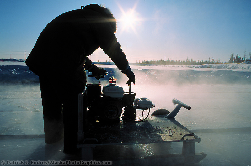 Custom chainsaw machine used to cut through thick ice in a pond to make blocks of ice for the World Ice Art Championships held each march in Fairbanks, Alaska