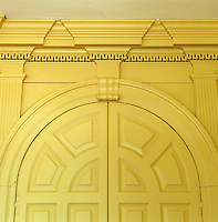 Detail of an arched cupboard built into the wood panelling of the drawing room