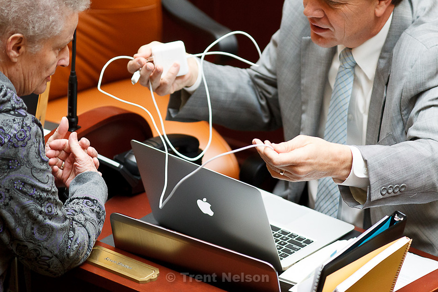 Trent Nelson  |  The Salt Lake Tribune.Utah legislators showed various levels of expertise after being asked to plug in their new Macbook Air laptops in the House chamber on the second day of the Utah legislative session in Salt Lake City Tuesday, January 29, 2013. The legislators were encouraged to use a hard-wired ethernet connection rather than the computers' built-in wireless connections. Rep. Keven J. Stratton