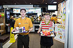© Joel Goodman - 07973 332324 . 14/08/2015 . Hyde , UK . Staff serving an order for customers who use McDonalds' new order screen and waited table service at their branch in Mottram , Hyde . Photo credit : Joel Goodman