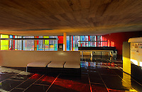 Grand Salon of the Maison du Bresil or Brazil House, designed by Le Corbusier (Charles-Edouard Jeanneret, 1887-1965) and Lucio Costa, 1902-1998, and inaugurated in 1954, with reflections from the coloured glass windows, in the Cite Internationale Universitaire de Paris, in the 14th arrondissement of Paris, France. The building is listed as a historic monument and was renovated 1999-2000 by Bernard Bauchet and Hubert Rio. The CIUP or Cite U was founded in 1925 after the First World War by Andre Honnorat and Emile Deutsch de la Meurthe to create a place of cooperation and peace amongst students and researchers from around the world. It consists of 5,800 rooms in 40 residences, accepting another 12,000 student residents each year. Picture by Manuel Cohen. L'autorisation de reproduire cette œuvre doit etre demandee aupres de l'ADAGP/Permission to reproduce this work of art must be obtained from DACS.