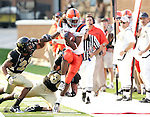 2 September 2006: Syracuse's Taj Smith (2) breaks a Wake Forest tackle for a big gain up the sideline. Wake Forest defeated Syracuse 20-10 at Groves Stadium in Winston-Salem, North Carolina in an NCAA college football game.