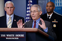 Director of the National Institute of Allergy and Infectious Diseases Dr. Anthony Fauci, with Vice President Mike Pence (L) and Surgeon General of the United States Jerome Adams (R), responds to a question from the news media during a COVID-19 coronavirus press conference at the White House in Washington, DC, USA, 14 March 2020. To date there are 2175 confirmed cases of COVID-19 coronavirus in the US with 50 deaths.<br /> Credit: Shawn Thew / Pool via CNP/AdMedia