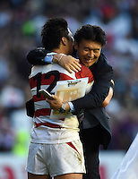 Harumichi Tatekawa of Japan celebrates with Japan Team Manager Omura Takenori. Rugby World Cup Pool B match between South Africa and Japan on September 19, 2015 at the Brighton Community Stadium in Brighton, England. Photo by: Patrick Khachfe / Onside Images