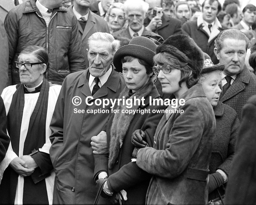 Marjorie Coulson, comforted by her father, 74 year old Richard Coulson, and a female family friend, at the funeral of her fiance, Senator Billy Fox, 35 years, Protestant, Fine Gael politician, Co Monaghan, Rep of Ireland, 14th March 1974. He was previously a TD (Irish MP).  Fox was visiting the home near Clones of his fiancee, Marjorie Coulson, which unknown to him had been taken over by thirteen armed paramilitaries. He ran from the scene but was followed and shot dead in a nearby field. Five members of the Provisional IRA were subsequently tried and convicted of the killing. 197403140164b. .Copyright Image from Victor Patterson, 54 Dorchester Park, Belfast, United Kingdom, UK...For my Terms and Conditions of Use go to http://www.victorpatterson.com/Victor_Patterson/Terms_%26_Conditions.html