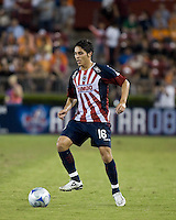 CD Guadalajara midfielder Edgar Solis (16) dribbles the ball.  CD Guadalajara defeated Houston Dynamo 1-0 during the group stage of the Superliga 2008 tournament at Robertson Stadium in Houston, TX on July 15, 2008.