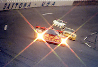 The #30 Porsche 962 of Gianpiero Moretti, Derek Bell, Costas Los, Stanley Dickens and Steve Phillips leads a pack of cras through the banking during the SunBank 24 at Daytona at Daytona Internatonal Speedway, Daytona Beach, FL, February 3-4, 1990.  (Photo by Brian Cleary/www.bcpix.com)