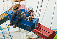 NWA Democrat-Gazette/BEN GOFF @NWABENGOFF<br /> Jennifer Rumsey and son Braxton Graves, 6, of Gentry take a spin on the 'Whirlwind' ride Saturday, Aug. 12, 2017, on the final day of the Benton County Fair in Bentonville.