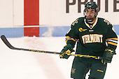 Yvan Pattyn (UVM - 15) - The visiting University of Vermont Catamounts defeated the Northeastern University Huskies 6-2 on Saturday, October 11, 2014, at Matthews Arena in Boston, Massachusetts.
