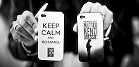 "Claims that read ""Keep calm and demolish!"" and ""Matteo Renzi Now!"" are seen on smartphone covers during Matteo Renzi's political campaign convention for the Partito Democratico's primary elections -Italian left wing Party - in Turin, October 21, 2012."