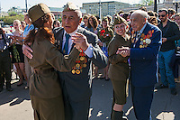 Moscow, Russia, 09/05/2013..Russian World War Two veterans in Gorky Park dance with well-wishers wearing Soviet era army uniforms during the country's annual Victory Day celebrations.
