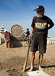 Mbah Maridjan cleans up the highest temple on Merapi in preparation for the Labuhan ceremony to appease the volcano's spirits in 2006. 6