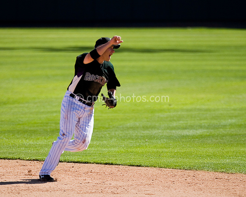 Mar 21, 2008; Tucson, AZ, USA;  Colorado Rockies shortstop Clint Barmes (12) reacts to a ball hit over his head during a game against the Chicago Cubs at Hi Corbett Field.