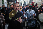Palestinian sufis perform during a celebration of the Islamic holiday of Isra Mi'raj, in the old city of the West Bank city of Nablus, April 03, 2019. The holiday marks what Muslims believe is the Prophet Mohammad's journey from Mecca to Jerusalem and it is believed to be followed by his ascension to heaven. Photo by Shadi Jarar'ah