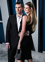 BEVERLY HILLS, LOS ANGELES, CALIFORNIA, USA - FEBRUARY 09: Adam Levine and wife Behati Prinsloo arrive at the 2020 Vanity Fair Oscar Party held at the Wallis Annenberg Center for the Performing Arts on February 9, 2020 in Beverly Hills, Los Angeles, California, United States. (Photo by Xavier Collin/PictureGroup)