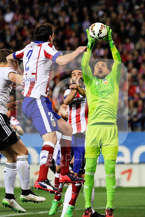 Atletico de Madrid´s Diego Godin and Valencia CF´s goalkeeper Diego Alves during 2014-15 La Liga match between Atletico de Madrid and Valencia CF at Vicente Calderon stadium in Madrid, Spain. March 08, 2015. (ALTERPHOTOS/Luis Fernandez)