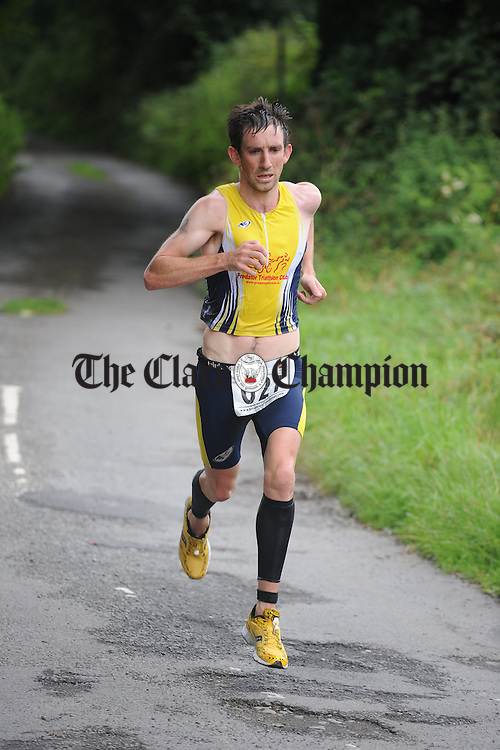Finishing the final leg of the road run during the Brian Boru Sprint Triathlon at Two-Mile-Gate,  Killaloe. Photograph by John Kelly.