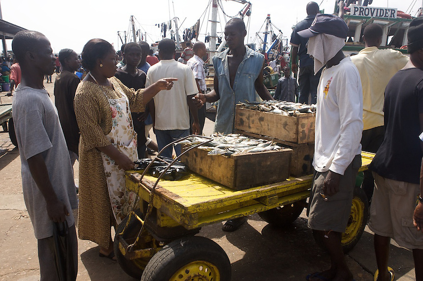 Buying fish, Tema, Ghana..Photograph by Peter E. Randall