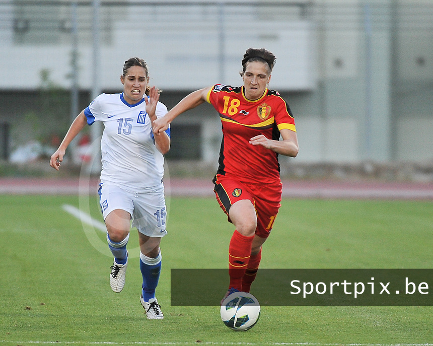 20131026 - LIVADIA , GREECE : Belgian Maud Coutereels (18) pictured with Greek Efhymia Michalakidi (15) during the female soccer match between Greece and Belgium , on the third matchday in group 5 of the UEFA qualifying round to the FIFA Women World Cup in Canada 2015 at the Levadia Municipal Stadium , Livadia . Saturday 26th October 2013. PHOTO DAVID CATRY