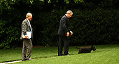 United States President George W. Bush, center, White House Deputy Chief of Staff Karl Rove, left, and first dog Barney, right, walk to the Oval Office of the White House after the President spoke  to the National Association of Realtors in Washington, DC on May 13, 2005.  <br /> Credit: Dennis Brack / Pool via CNP