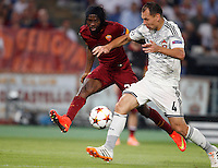 Calcio, Champions League, Gruppo E: Roma vs CSKA Mosca. Roma, stadio Olimpico, 17 settembre 2014.<br /> Roma forward Gervinho, of Ivory Coast, is challenged by CSKA Moskva defender Sergei Ignashevic, right, during the Group E Champions League football match between AS Roma and CSKA Moskva at Rome's Olympic stadium, 17 September 2014.<br /> UPDATE IMAGES PRESS/Riccardo De Luca