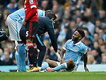 Raheem Sterling of Manchester City holds his groin which led to him being substituted during the Barclays Premier League match at The Etihad Stadium. Photo credit should read: Simon Bellis/Sportimage
