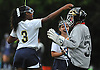 Kailey Brower, Baldwin goalie, right, gets congratulated by teammate #3 Kayla Brown after posting a shutout in the Lady Bruins' 2-0 victory over New Hyde Park in a Nassau County Conference I varsity field hockey match at Baldwin High School on Wednesday, Sept. 28, 2016.