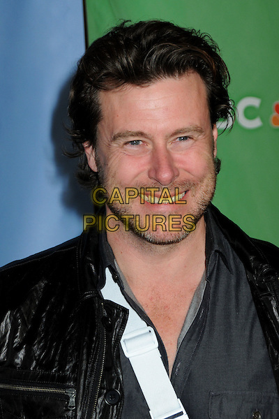 DEAN McDERMOTT .NBC Universal Press Tour Cocktail Party held at the Langham Hotel, Pasadena, California, USA, 10th January 2010..portrait headshot beard facial hair smiling black leather  .CAP/ADM/BP.©Byron Purvis/AdMedia/Capital Pictures.