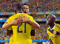 CUIABA - BRASIL -24-06-2014. James Rodriguez (#10), Jackson Martinez (#21) y Pablo Armero (#7) jugadores de Colombia (COL) celebran un gol anotado a Japón (JPN) durante partido del Grupo C de la Copa Mundial de la FIFA Brasil 2014 jugado en el estadio Arena Pantanal de Cuiaba./ James Rodriguez (#10), Jackson Martinez (#21) and Pablo Armero (#7) players of Colombia (COL) celebrate a goal scored to Japan (JPN) during the macth of the Group C of the 2014 FIFA World Cup Brazil played at Arena Pantanal stadium in Cuiaba. Photo: VizzorImage / Alfredo Gutiérrez / Contribuidor