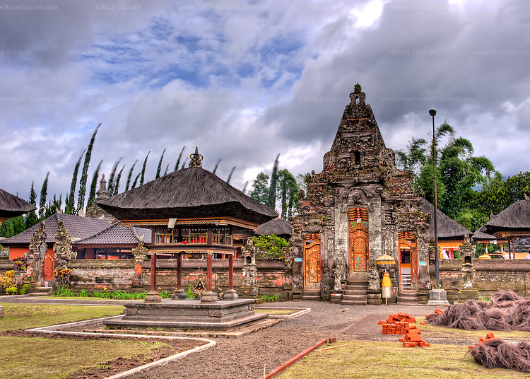 The courtyard and main entrance door to the inner temple at the temple in Candikuning, on Bali, Indonesia. The Hindu temple of Ulun Danu at Candikuning is one of the iconic images of Bali.  Located in the high hills of the Bedugul, about 30 miles north of Bali's capital city of Denpasar, the temple is built on the shores of the crater Lake Bratan (formed from the sunken crater of a long-dormant volcano).  Much of the inner precincts of the temple is closed to the (non-Hindu) public, but the gardens are spectacular and feature fabulous shrines, statuary, and views.  (HDR image)