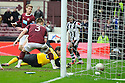 HEARTS' MARIUS ZALIUKAS DEFLECTS ST MIRREN'S NIGEL HASSELBAINK CROSS INTO HIS OWN NET FOR ST MIRREN'S EQUALISER