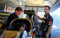 Sept. 22, 2012; Ennis, TX, USA: NHRA crew chief Aaron Brooks (right) for top fuel dragster driver Morgan Lucas during qualifying for the Fall Nationals at the Texas Motorplex. Mandatory Credit: Mark J. Rebilas-