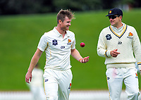 Wellington's Jimmy Neesham and Hamish Bennett on day one of the Plunket Shield cricket match between the Wellington Firebirds and Otago Volts at Basin Reserve in Wellington, New Zealand on Monday, 21 October 2019. Photo: Dave Lintott / lintottphoto.co.nz