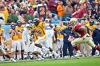 January 01, 2010:   West Virginia quarterback Jarrett Brown (16) runs for a touchdown during Konica Minolta Gator Bowl College football action between the West Virginia Mountaineers and the Florida State Seminoles played at the Jacksonville Municipal Stadium in Jacksonville, Florida on January 01, 2010.  Florida State defeated West Virginia 33-21.