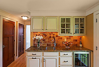 Arts & Craft style kitchen with painted cabinets, glass door wine cooler, ceramic tile.