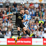 Aaron Mooy of Huddersfield Town  in action with Matt Ritchie of Newcastle United during the premier league match at the John Smith's Stadium, Huddersfield. Picture date 20th August 2017. Picture credit should read: Simon Bellis/Sportimage