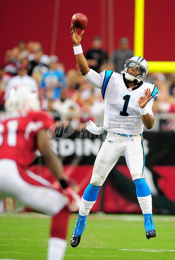 Sept. 11, 2011; Glendale, AZ, USA; Carolina Panthers quarterback (1) Cam Newton throws a pass in the first half against the Arizona Cardinals at University of Phoenix Stadium. Mandatory Credit: Mark J. Rebilas-