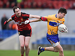 Jamie Malone of  Clare in action against Conaill Mc Govern of Down during their Division 2, Round 2 National League game at Cusack Park. Photograph by John Kelly.