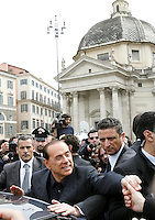 Il leader del Popolo della Liberta' Silvio Berlusconi saluta i suoi simpatizzanti dopo aver presentato il Camper della Liberta' in Piazza del Popolo, Roma, 12 marzo 2008..Leader of the People of Freedom's center-right coalition Silvio Berlusconi, bottom center, waves to sympathizers after presenting the Camper of Freedom in Rome's Piazza del Popolo, 12 march 2008..UPDATE IMAGES PRESS/Riccardo De Luca