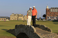 Damien McGrane (IRL) and Peter Lawrie (IRL) on the Swilcan Bridge on the 18th fairway during Round 2 of the 2015 Alfred Dunhill Links Championship at Kingsbarns in Scotland on 2/10/15.<br /> Picture: Thos Caffrey | Golffile