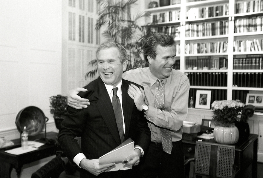 Republican presidential candidate George W. Bush celebrates after the poll results come in on election night with his brother Jeb Bush in the Governor's Mansion in Austin, Texas.