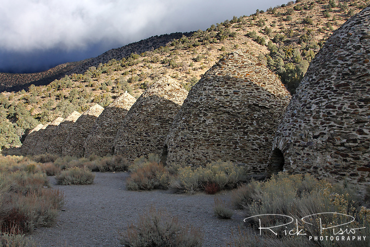Located in Death Valley National Park's Wildrose Canyon the Wildrose Charcoal Kilns are considered to be the best surviving examples of such kilns in the western United States. The kilns were only used for a short time around 1878 to provide charcoal to power nearby smelters. There are 10 kilns at the site each standing 25 feet tall with a circumfrence of 30 feet. Each kiln was capable of converting 42 cords of pinyon pine logs into 2,000 bushels of charcoal in one weeks time.