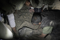 July 15, 2015 - Sa'dah, Yemen: The mother of Bashar Al Asadi, 14 years-old (not pictured), is rescued from the rubble of a house building after it was hit by a fighter jet from the Saudi-led coalition in the northern city of Sa'dah, the stronghold of the Houthi movement in Yemen. The family of Bashar was buried under the rubble during the attack. Two members of his family, the mother and one brother (not pictured) died from their injuries, while his sister (not pictured) survived. (Photo/Narciso Contreras)