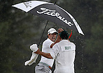 AUGUSTA, GA - APRIL 14: Adam Scott of Australia celebrates with Caddie Steve Williams after sinking a birdie putt on the 18th green to force a playoff with Angel Cabrera of Argentina during the Final Round of the 2013 Masters Golf Tournament at Augusta National Golf Club on April 14, 2013 in Augusta, Georgia. Steve Williams, Tiger Woods longtime caddie before he was controversially let go, has won the Masters before as a caddie. As Scott noted after the round, Stevie read the winning putt for him, because the Aussie could barely see the cup due to the darkness settling in down in the valley at the 10th green. Adam Scott became the first Australian ever to win the famed Masters Golf Tournament, one of the four major championships, in it's 79 year history.