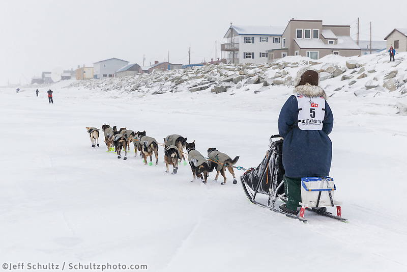 Dan Kaduce runs on the sea ice nearing the Nome finish line on Thursday March 13 during the 2014 Iditarod Sled Dog Race.<br /> <br /> PHOTO (c) BY JEFF SCHULTZ/IditarodPhotos.com -- REPRODUCTION PROHIBITED WITHOUT PERMISSION