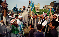 Peshawar / Pakistan.Activists of the Pakistani fundamentalist Islamic party Jamaat-i-Islami (JI) hold national flags and shout slogans against USA and NATO intervention in Afghanistan. .Photo Livio Senigalliesi