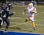 WATERBURY, CT-112117JS22- Gilbert-Northwestern's Billy Komons (1) runs in for a touchdown past WCA's Nicholas Goodson (9) and Justin Rodriguez (25) during their game Tuesday at Municipal Stadium in Waterbury. <br /> Jim Shannon Republican-American